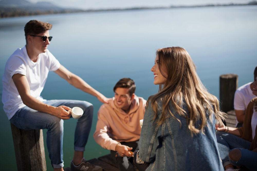 group of people sitting on boat dock