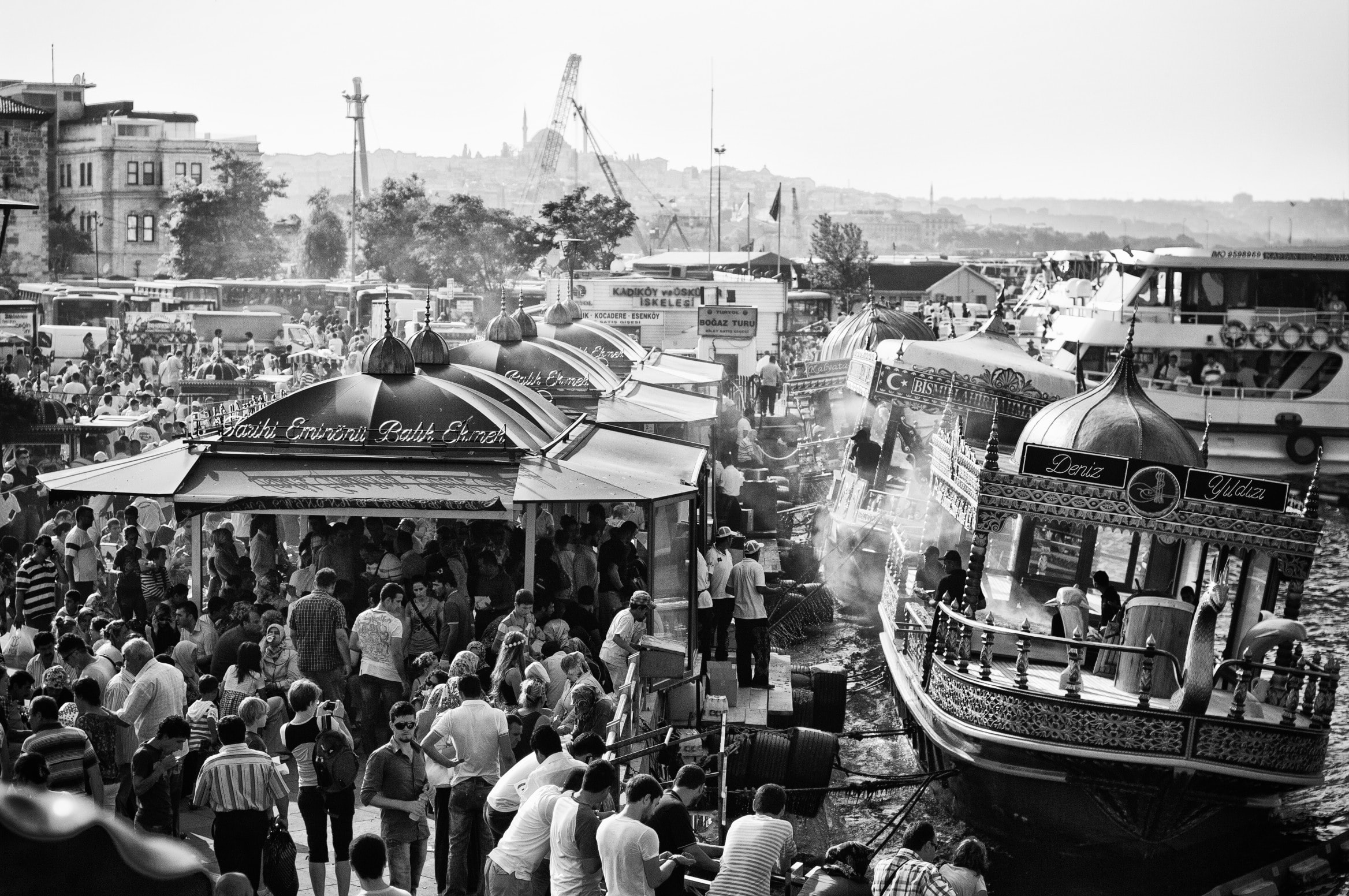 grayscale photo of people riding boats