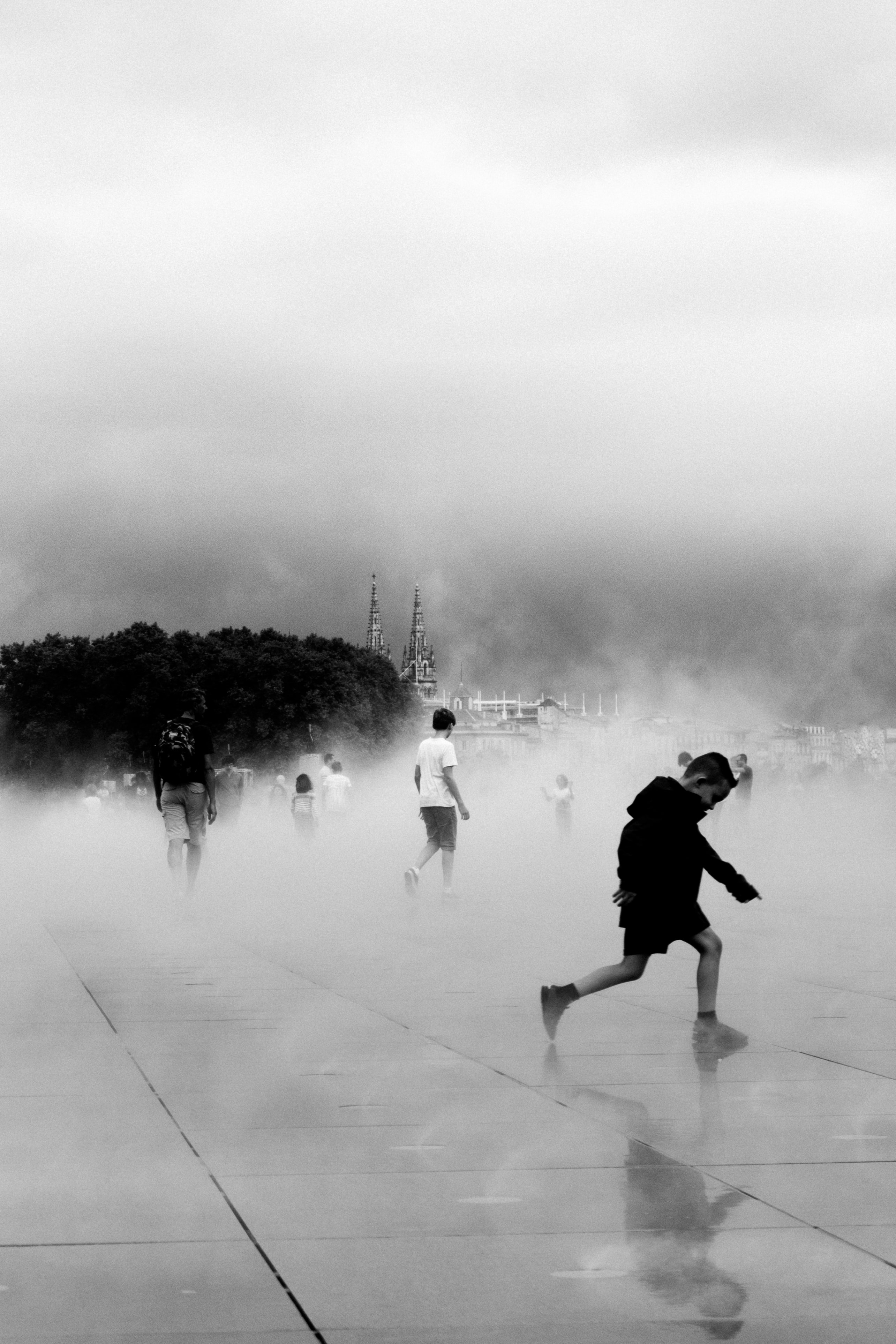 grayscale photo of boy running