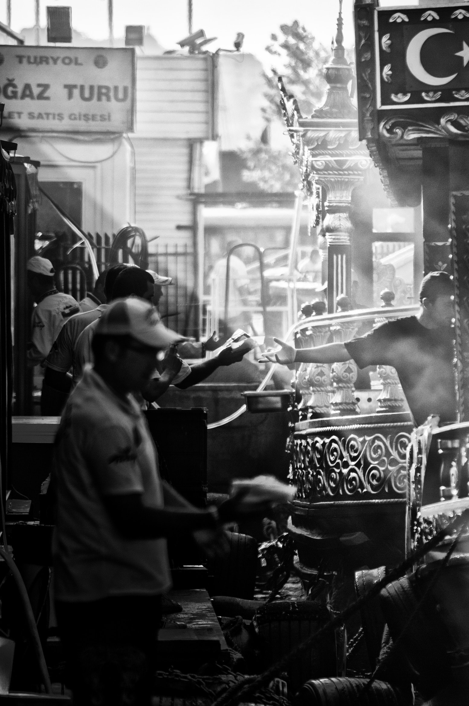 man giving man box in grayscale photography