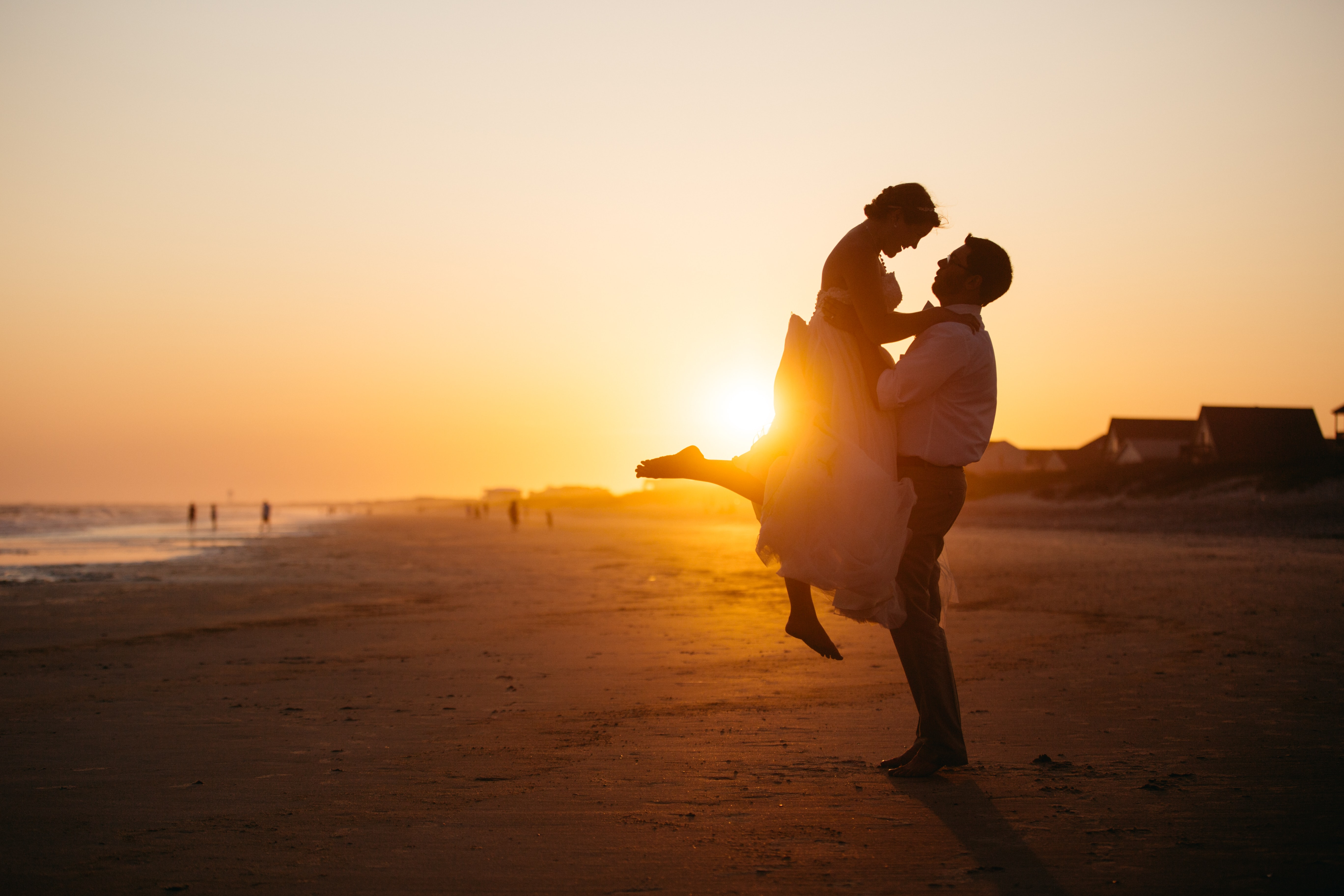 silhouette photo of man and woman on seashore
