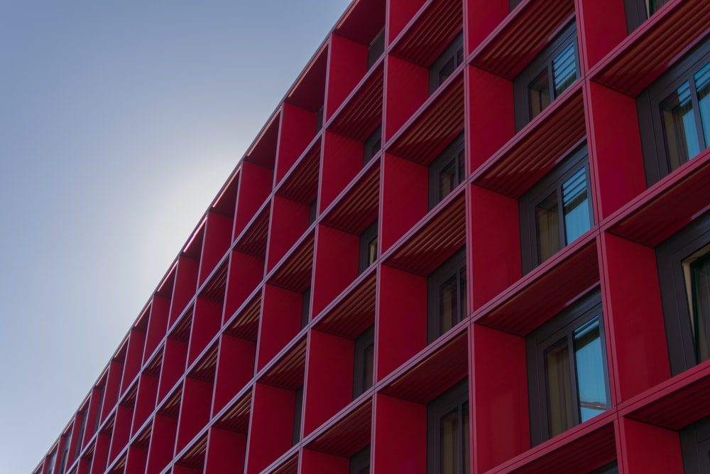 low angle photography of red high-rise building