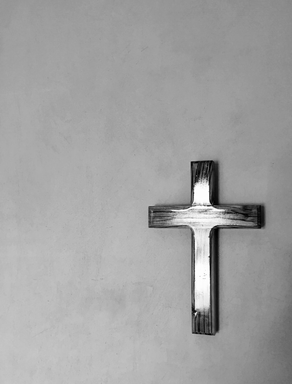 cross mounted on gray painted wall