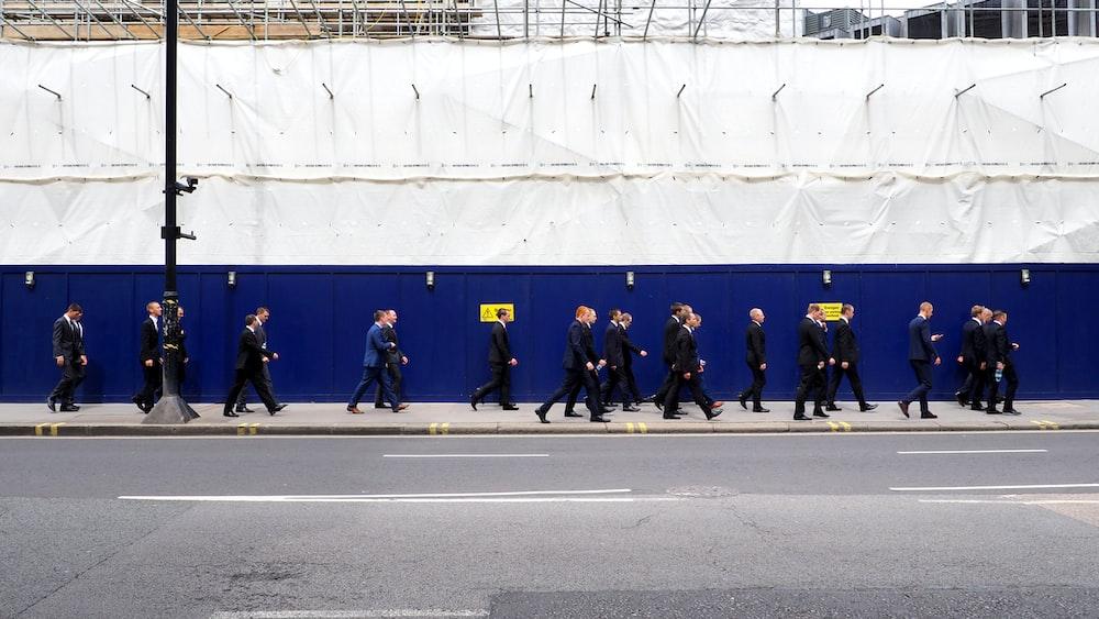 men walking on sidewalk