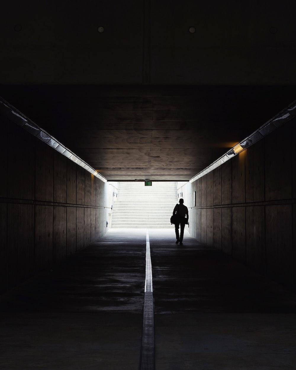 man walking on underpass