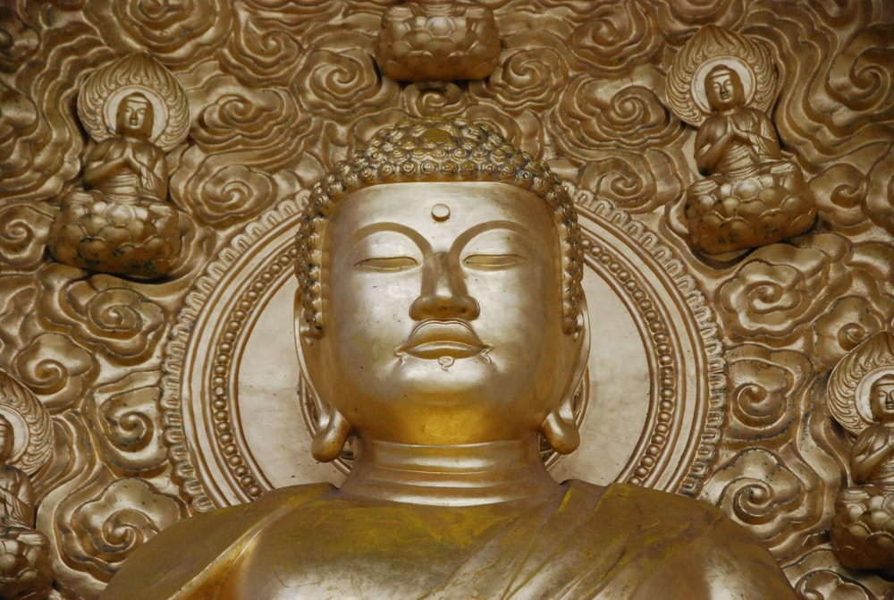 brown Gautama buddha statue