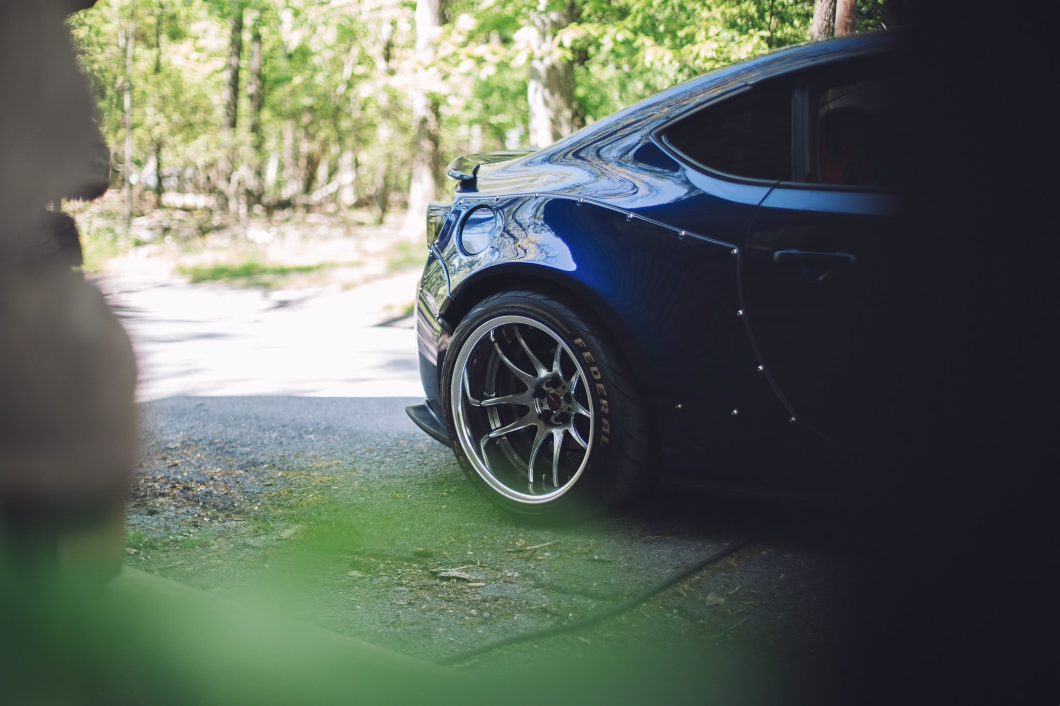 blue car on gray concrete