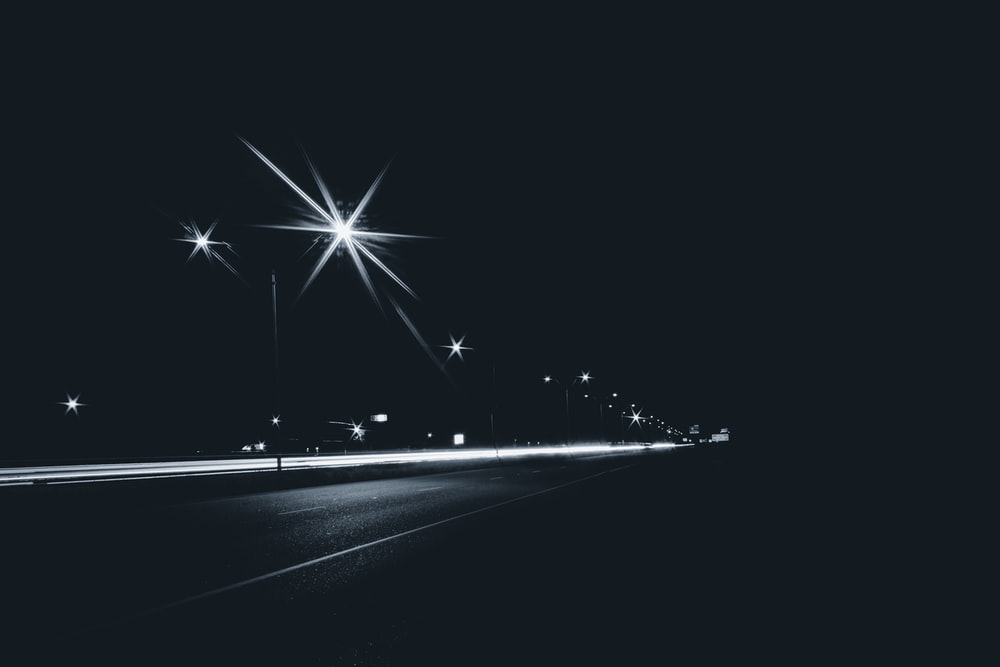 grayscale photography of time-laps of road