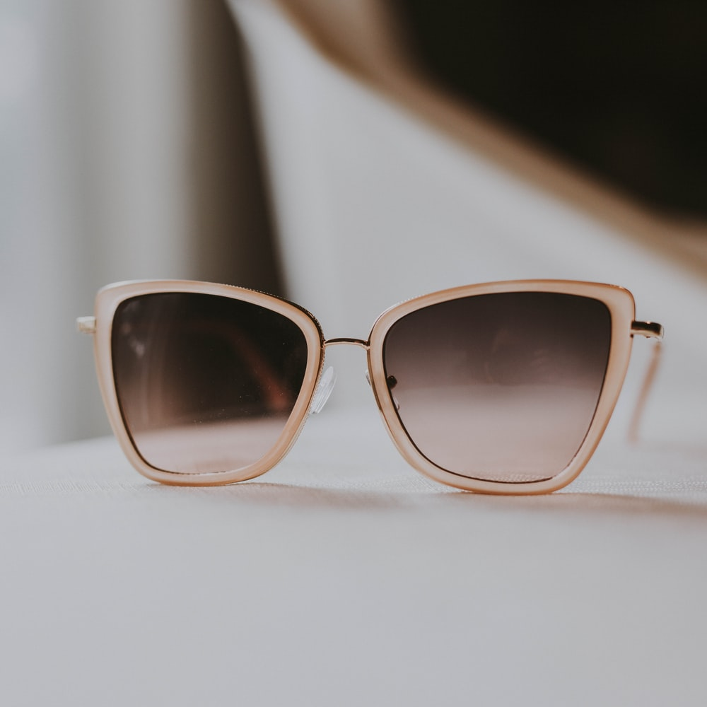 gray sunglasses with white frames