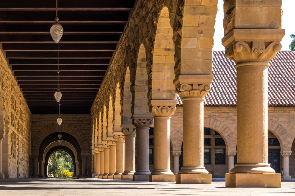 brown concrete hallways with columns