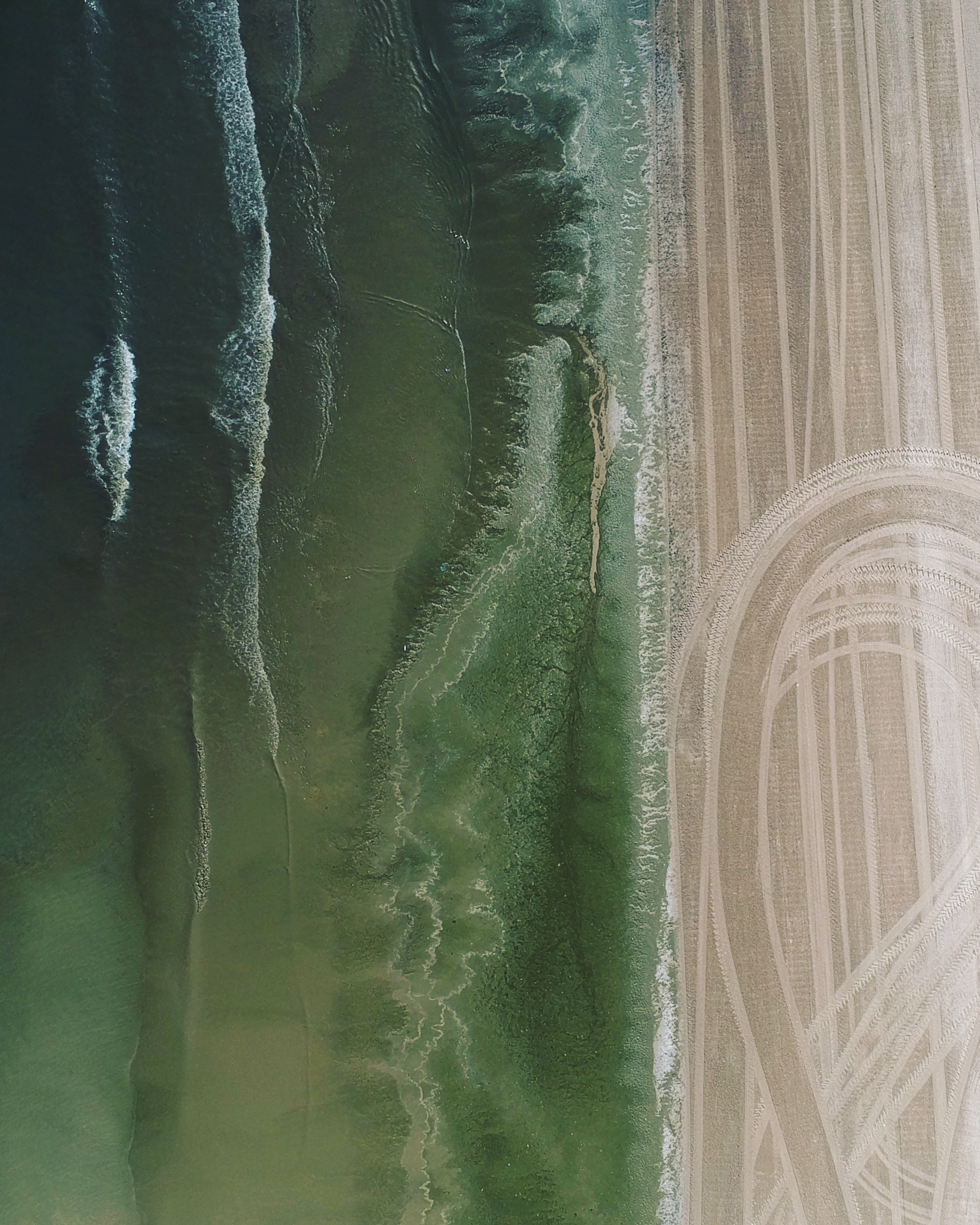 aerial photo of soil and body of water