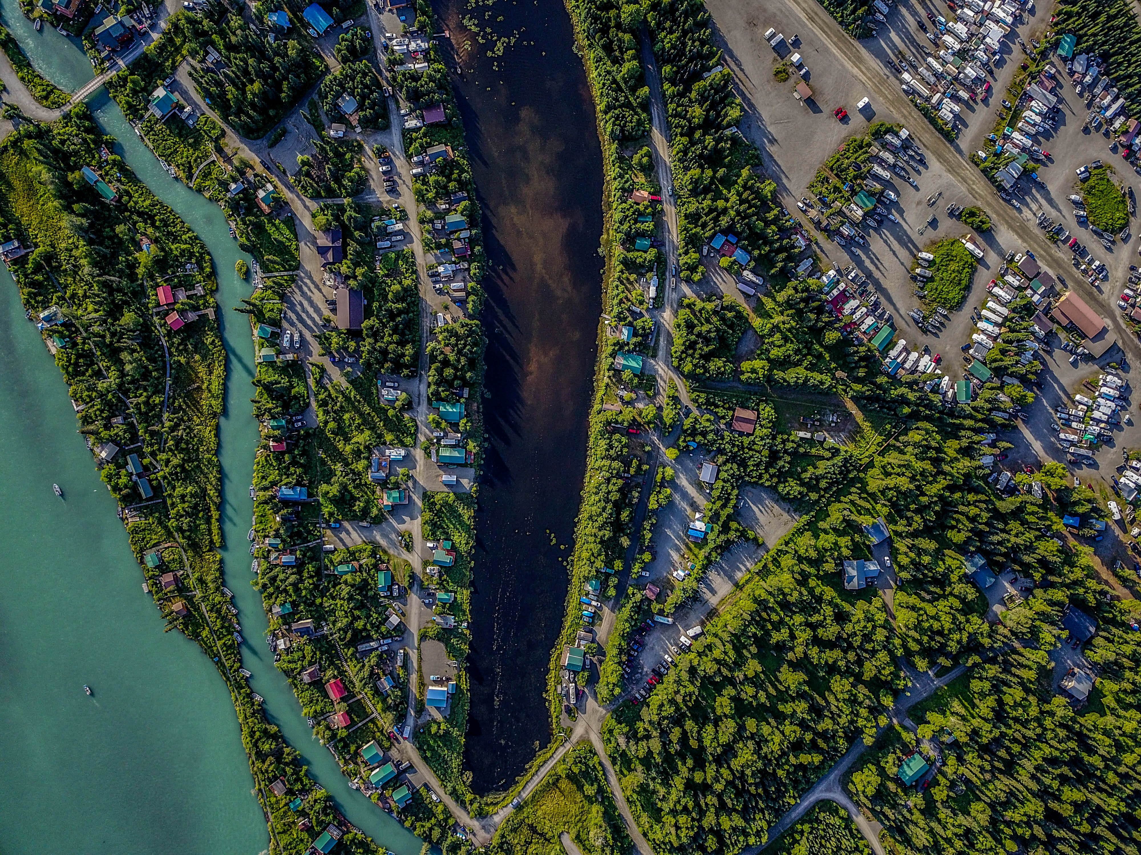 aerial photography of body of water and houses