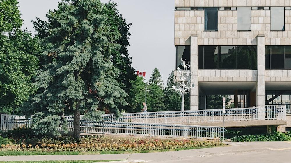 beige concrete building with wheelchair ramp