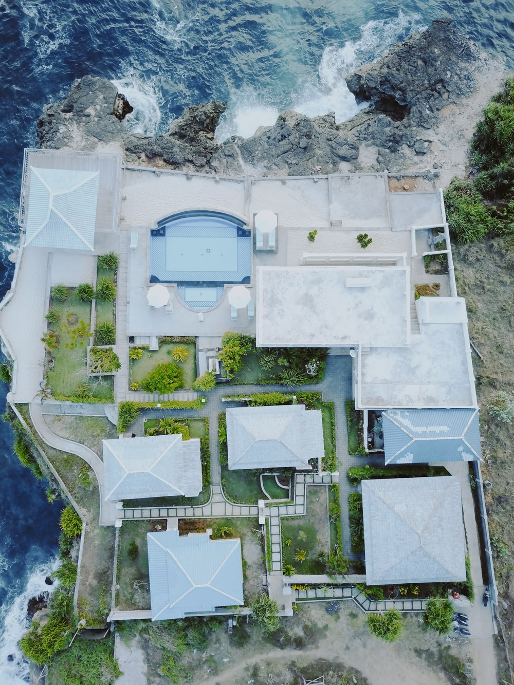 aerial view photography of house beside body of water