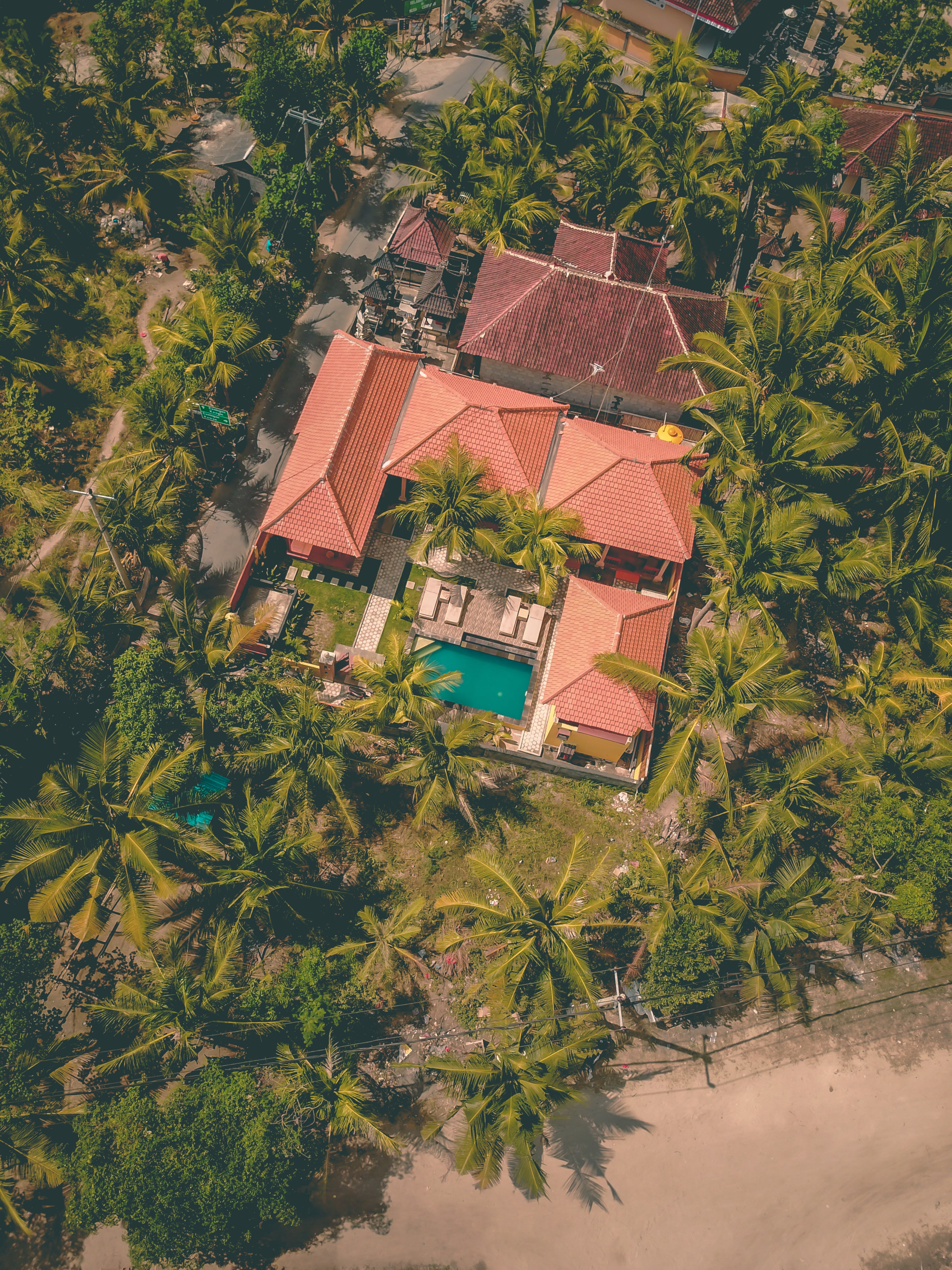 aerial photo of concrete house with swimming pool