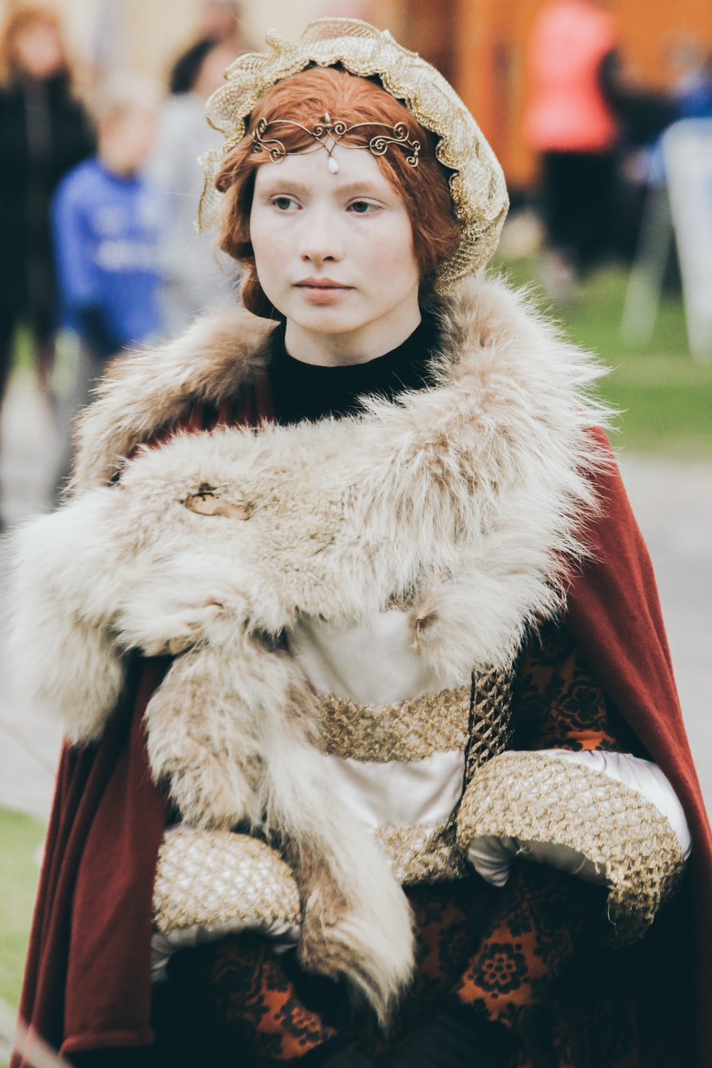 woman wearing red and white fur coat