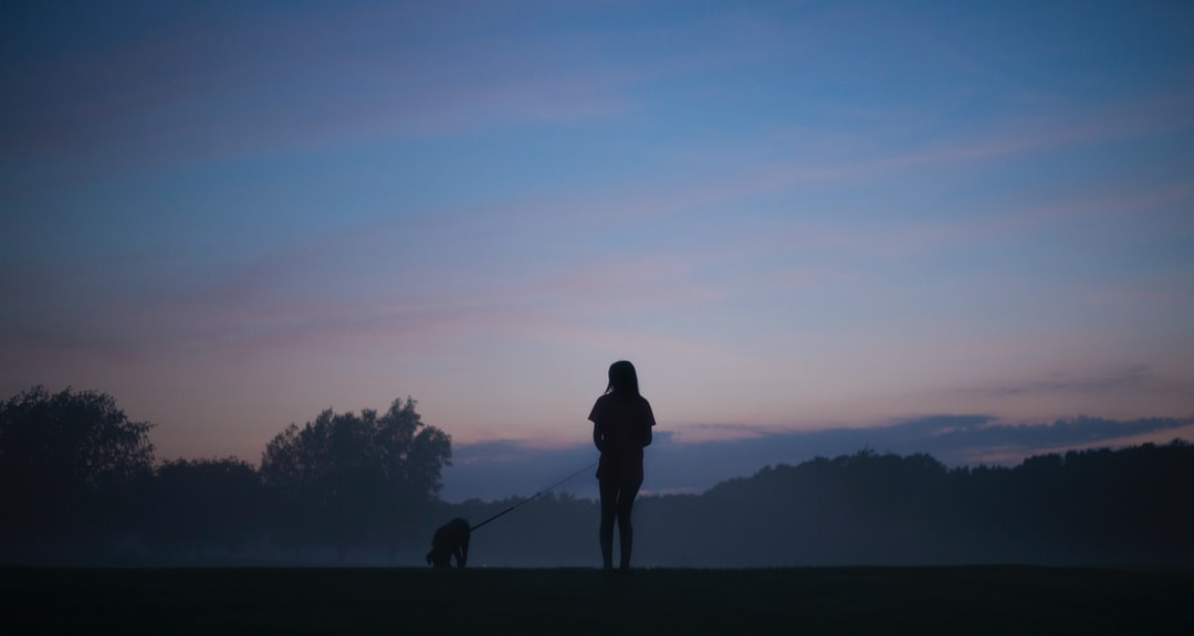 This is my sister walking our dog. We were out on the golf course by our house, and this beautiful fog rolled in off the pond.