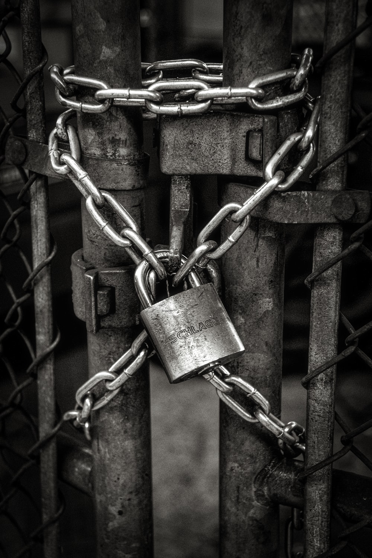 gray steel chain locked on gate