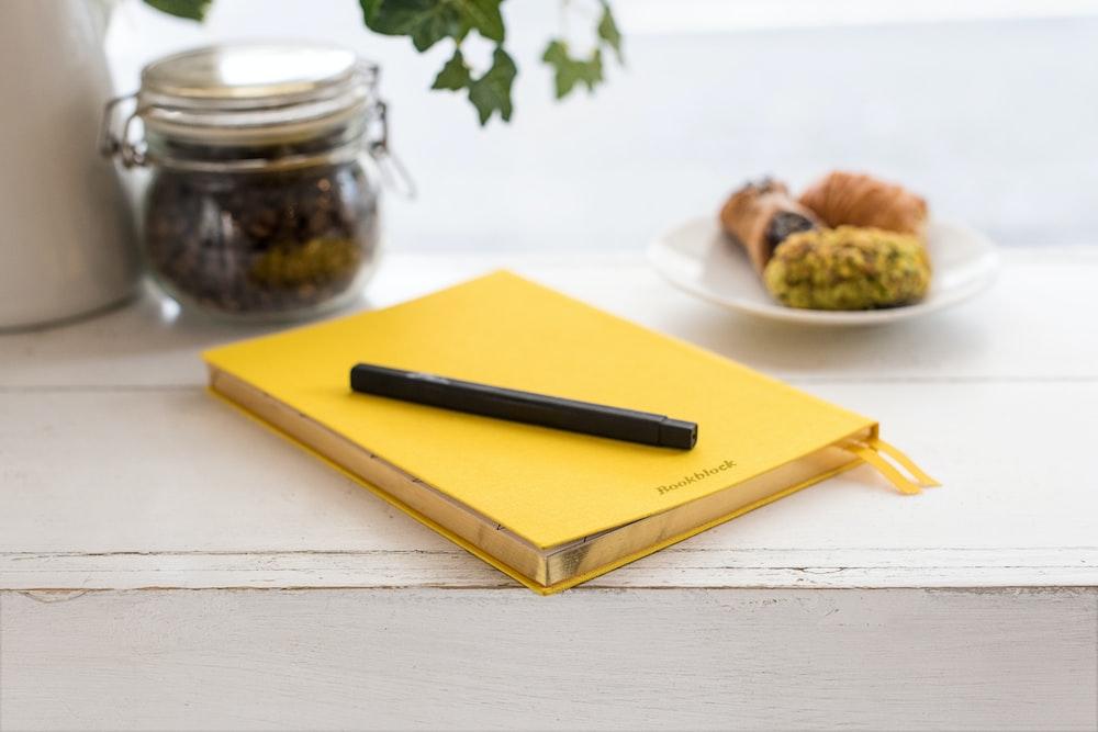 pen on book binder