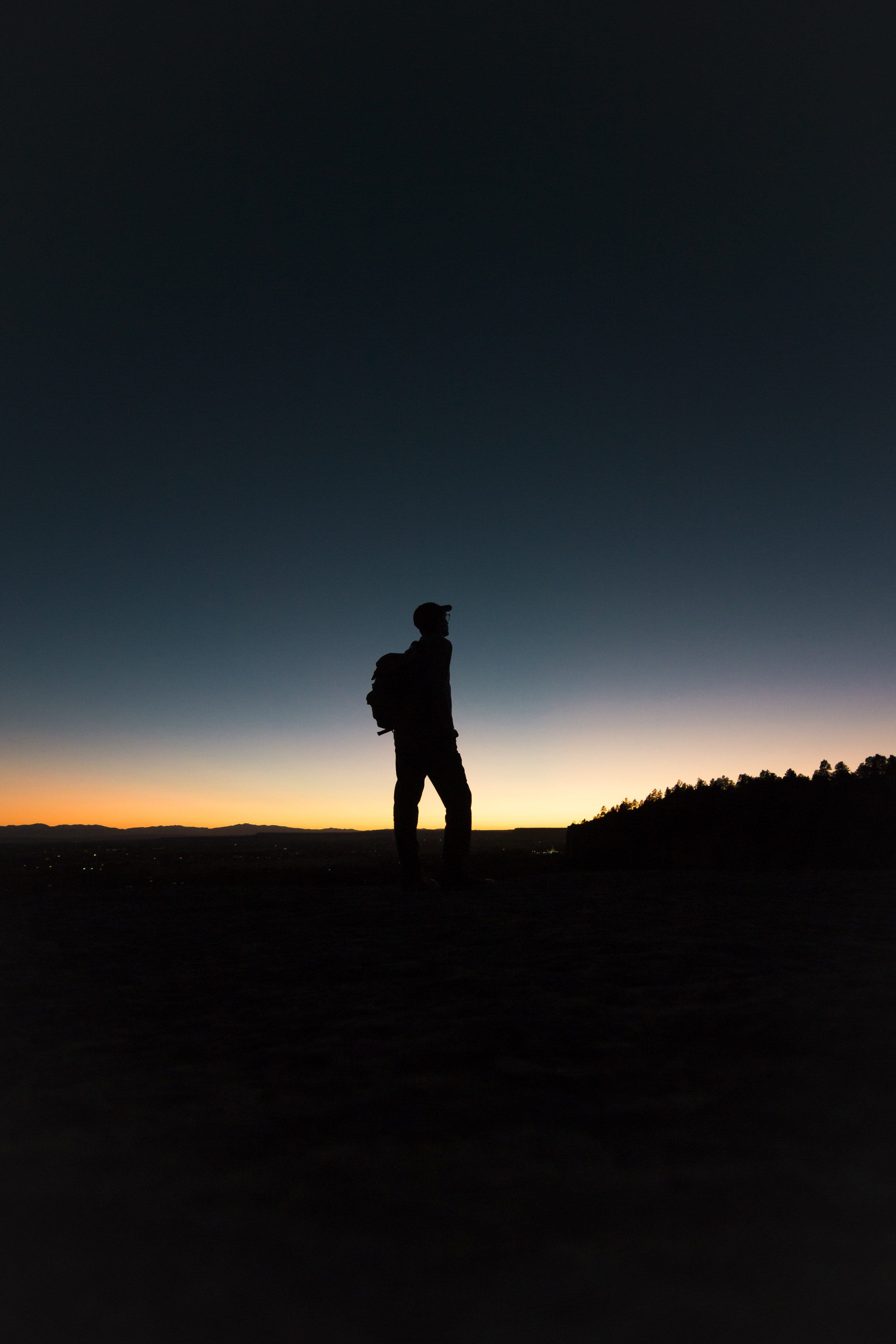 man with backpack in silhouette