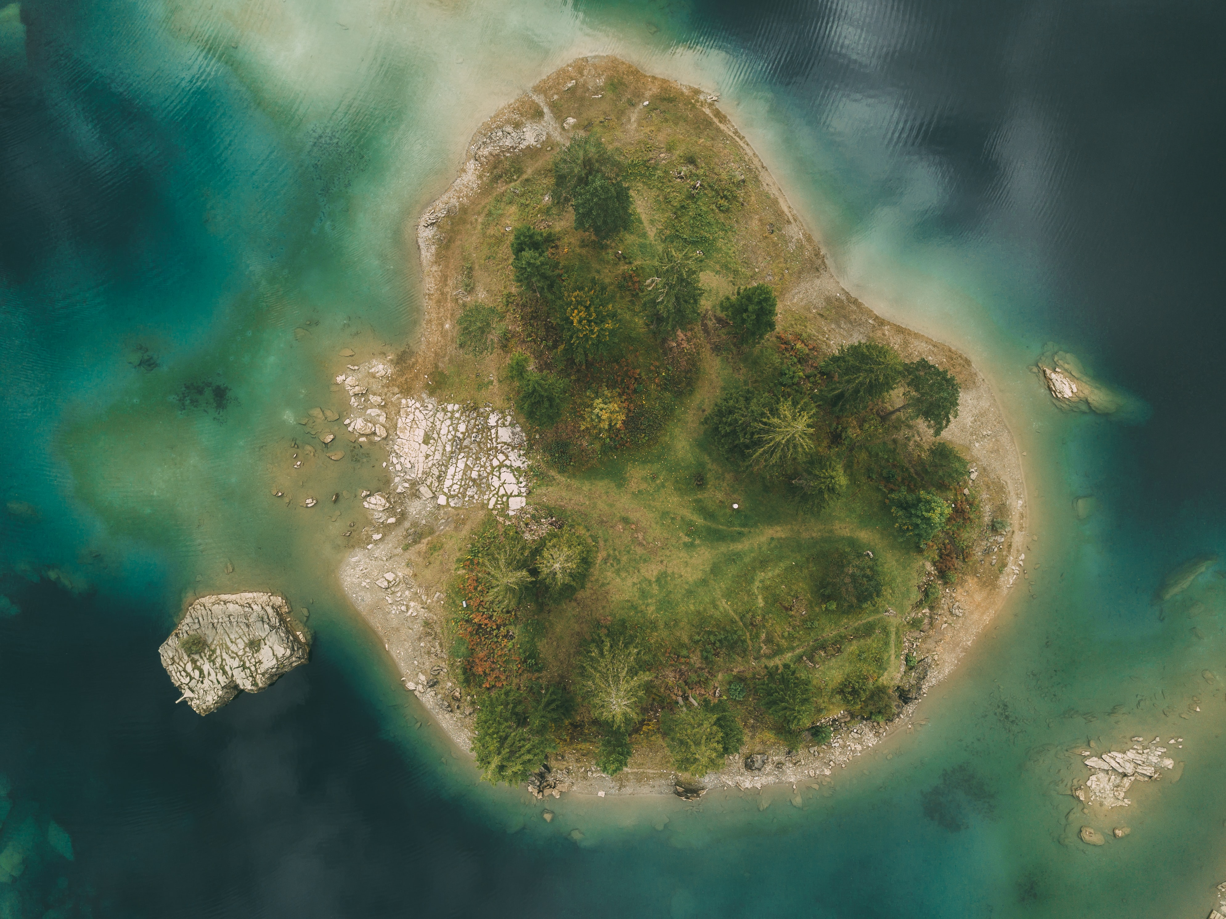 aerial photography of green island surrounded by water