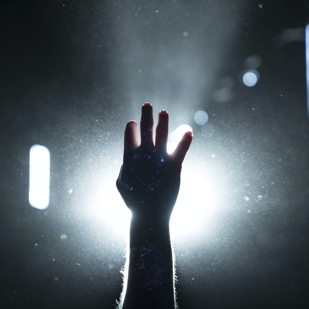 person's hand on light