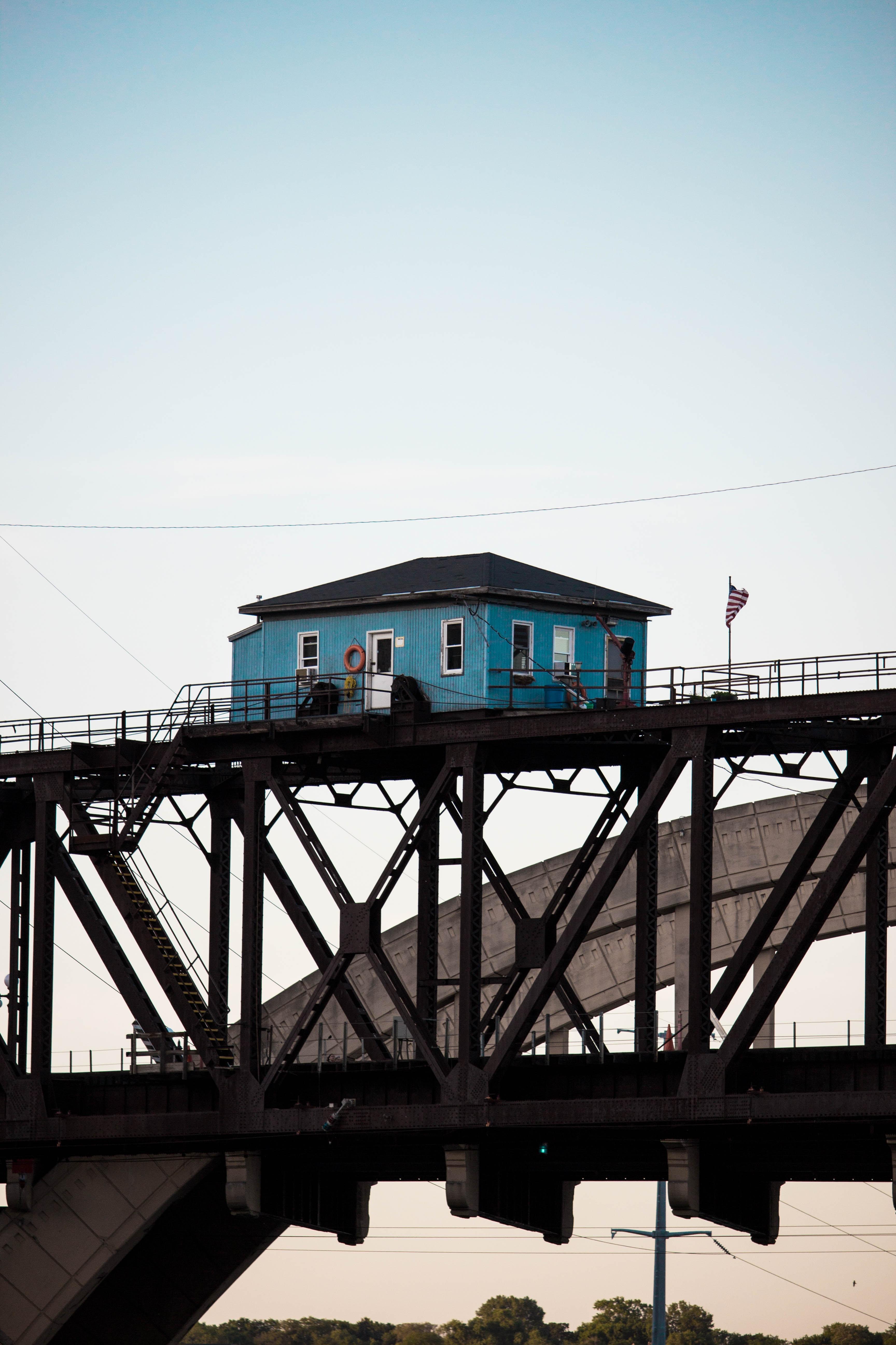 blue wooden house above bridge