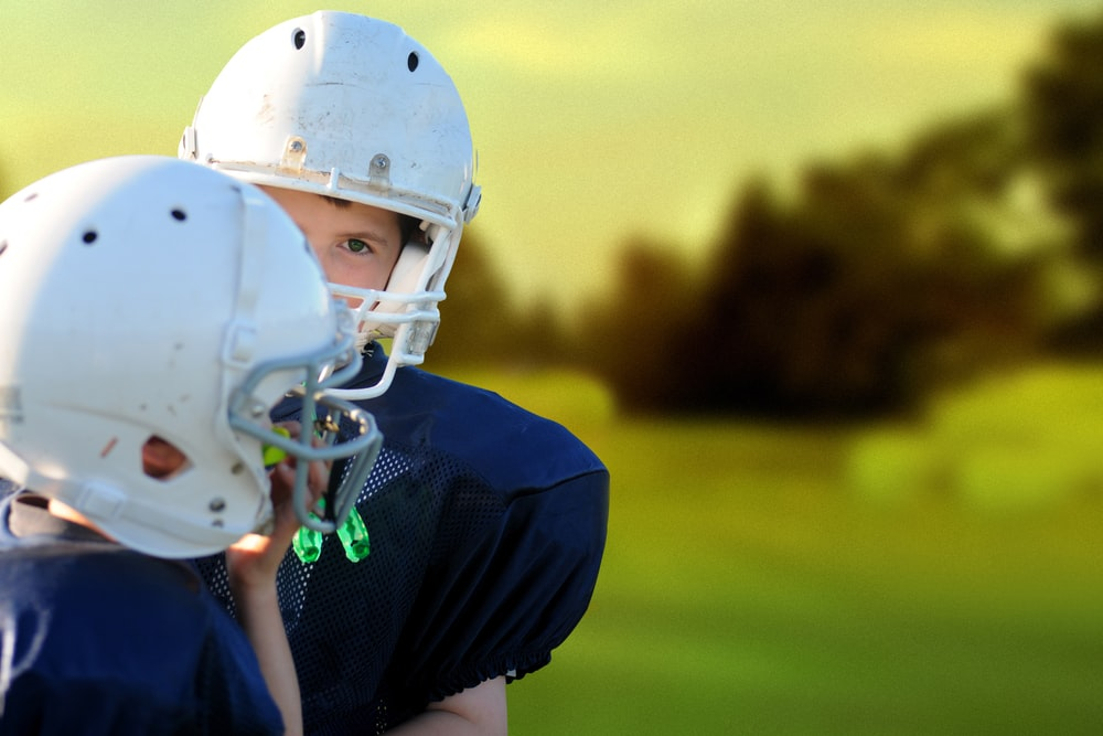 selective focus photography of two football players