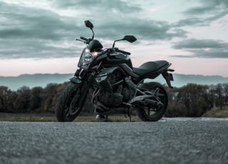 black and gray motorcycle low angle photography