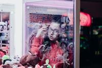 woman inside claw machine