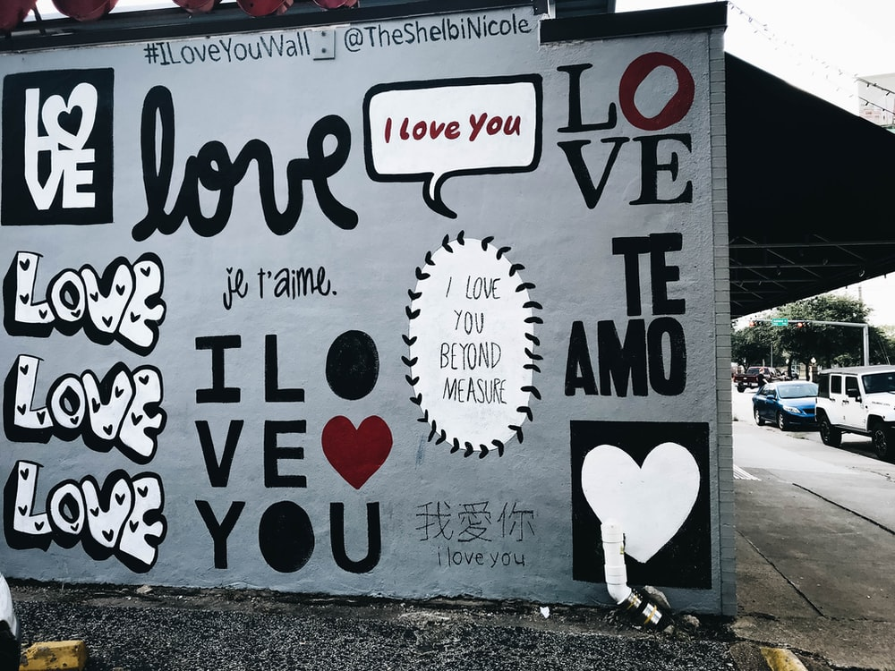 white wall with love graffiti