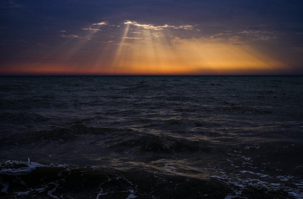 sun rays on body of water