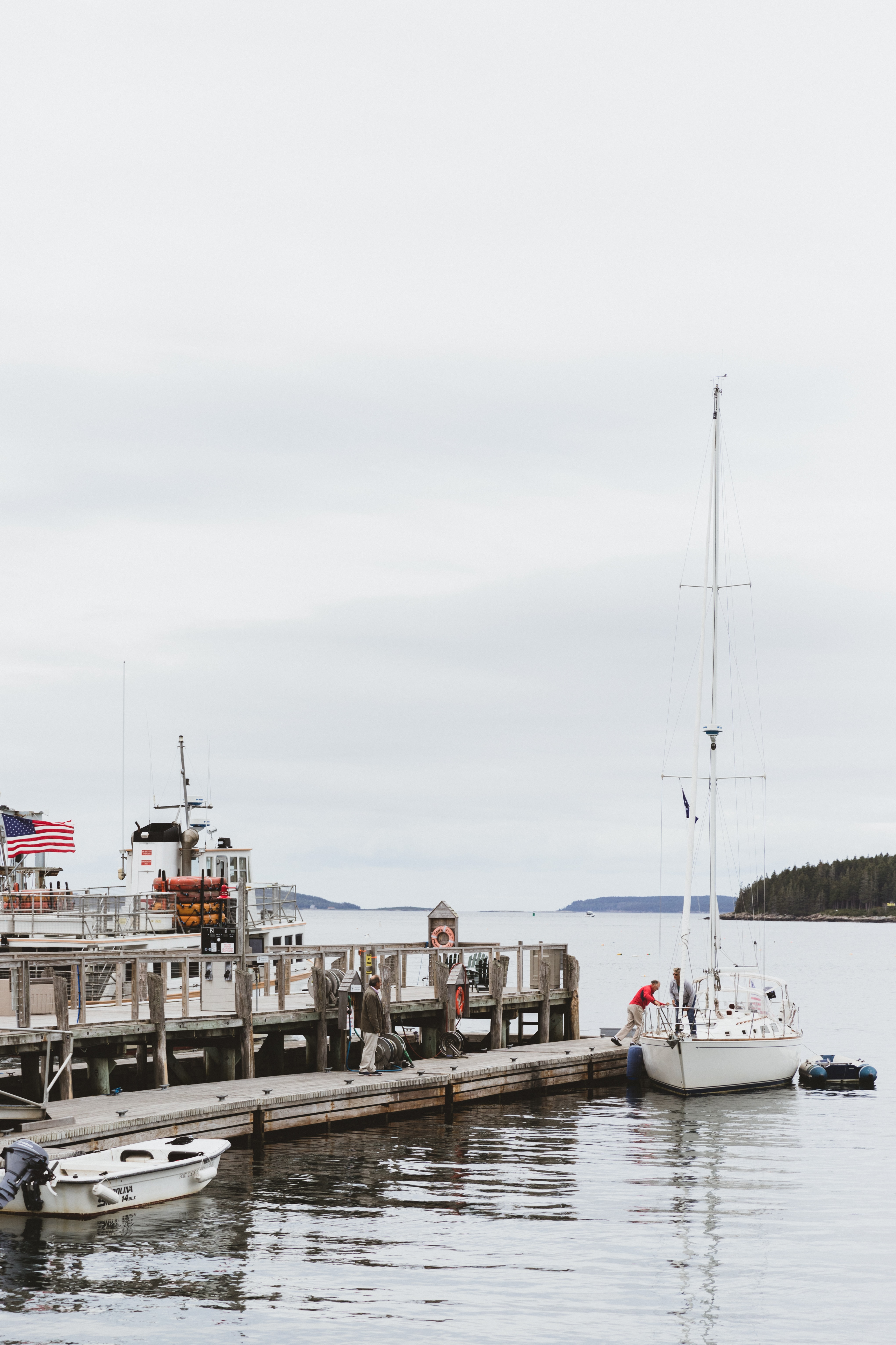 photo of a fishing vessel near on the concrete floor