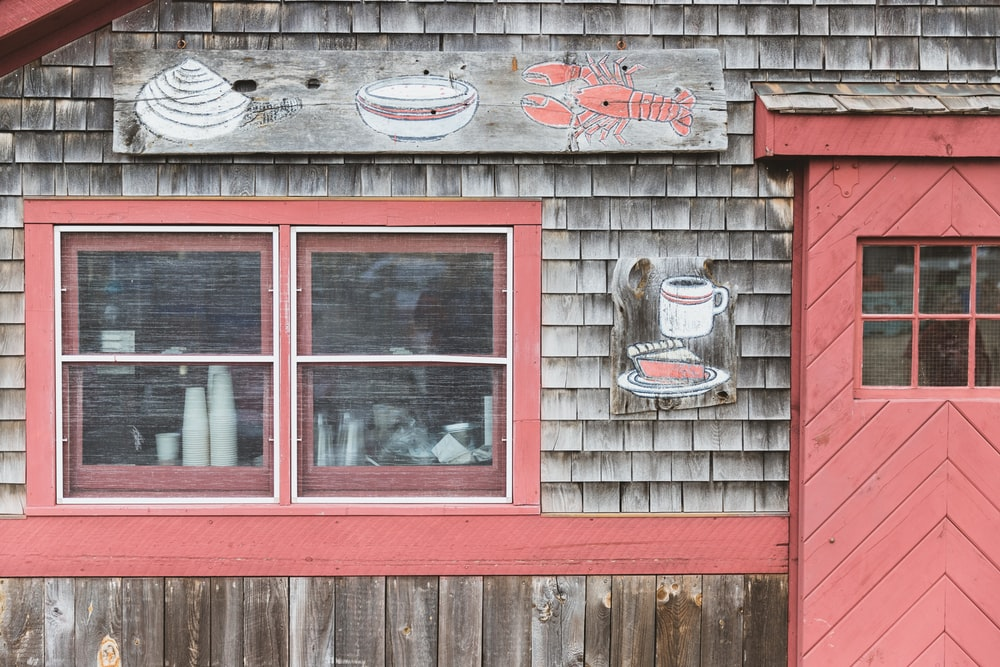 pink and gray wooden cafe front