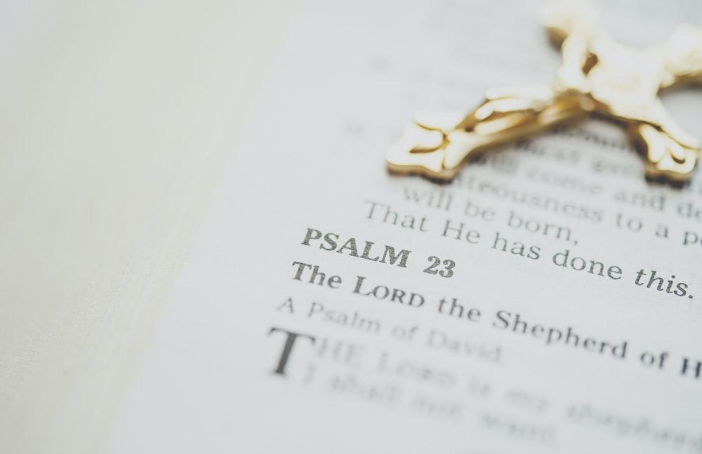gold-colored crucifix