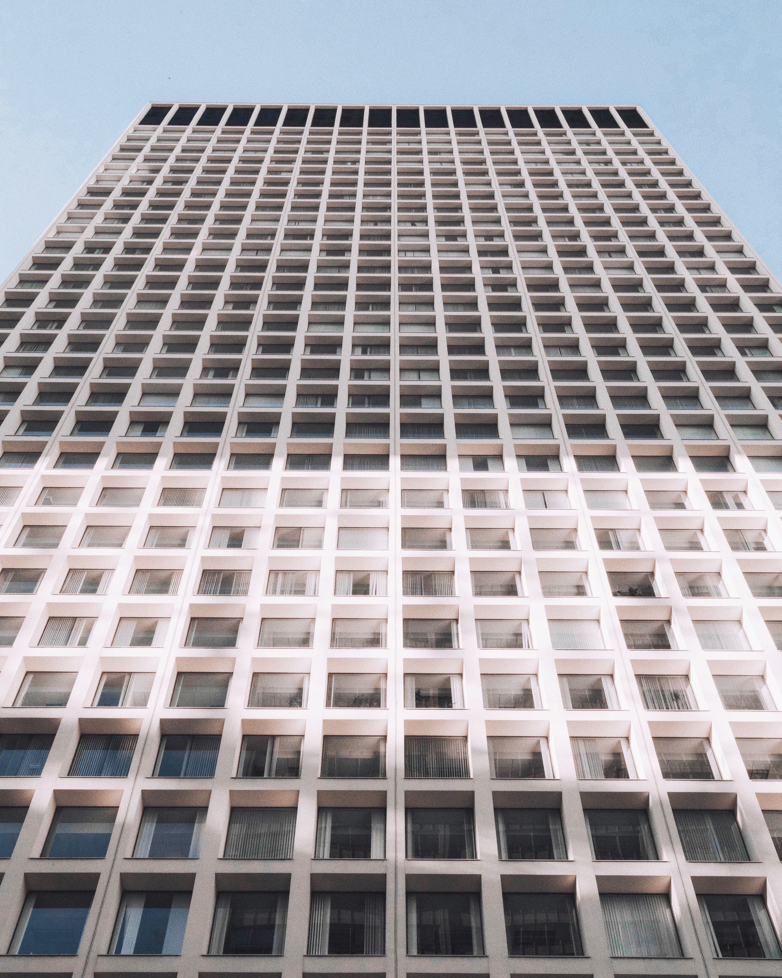 minimalist photography of white and gray high-rise building