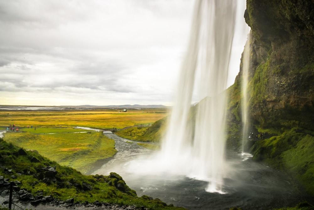 waterfall beside grassland
