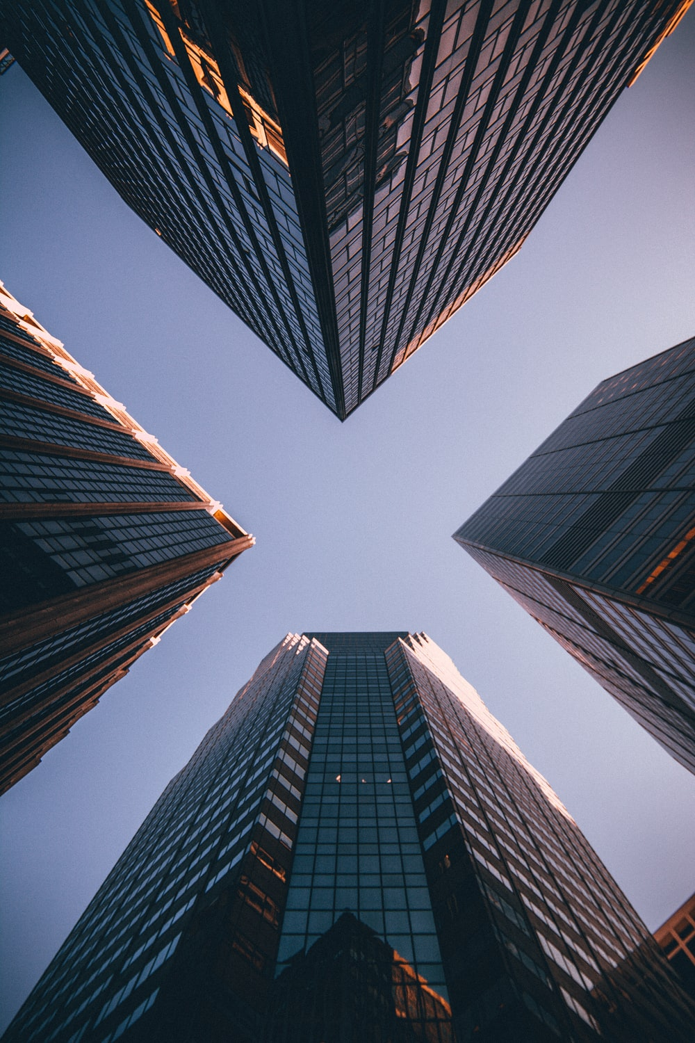 low-angle photography of four high-rise buildings