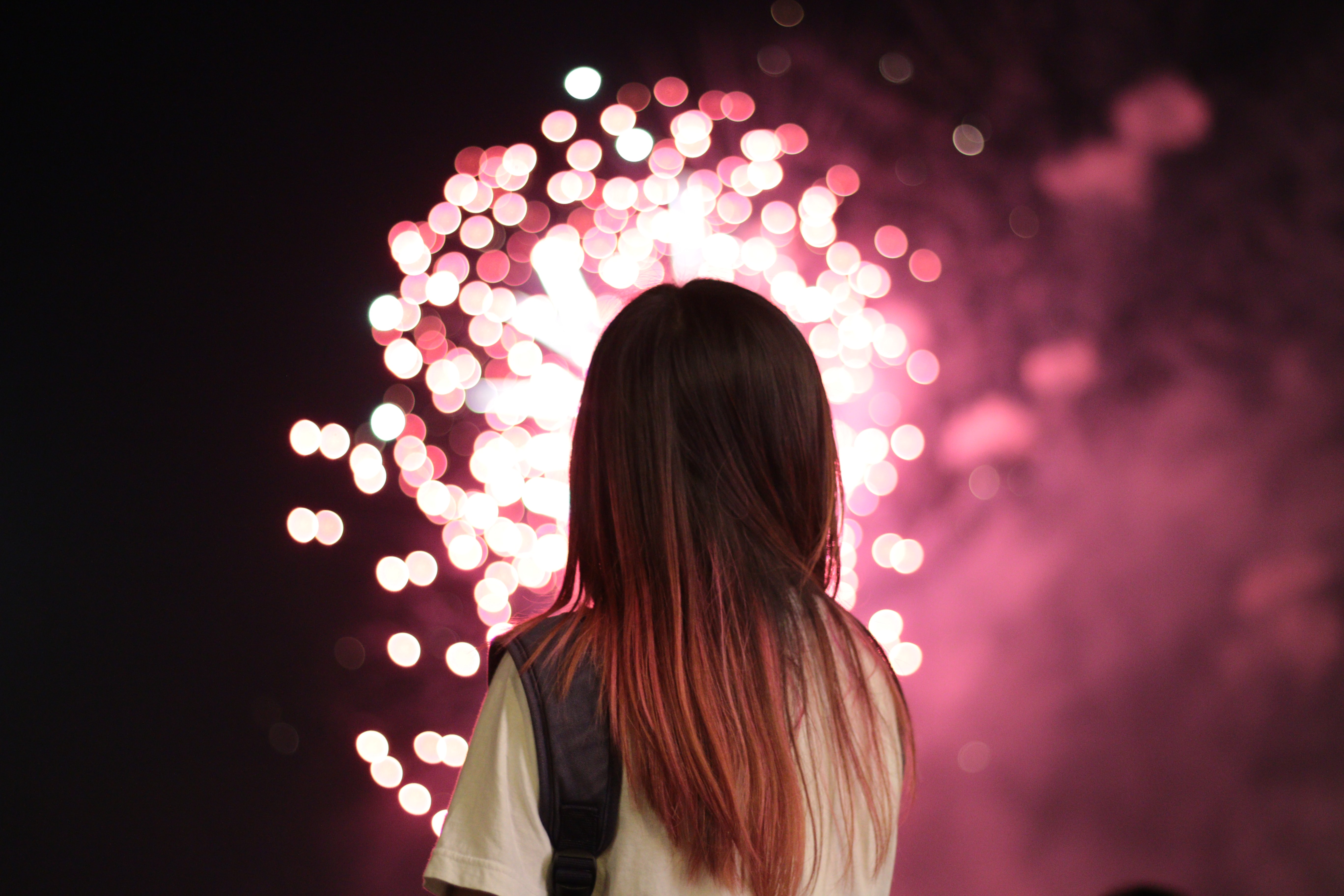 woman staring at fireworks