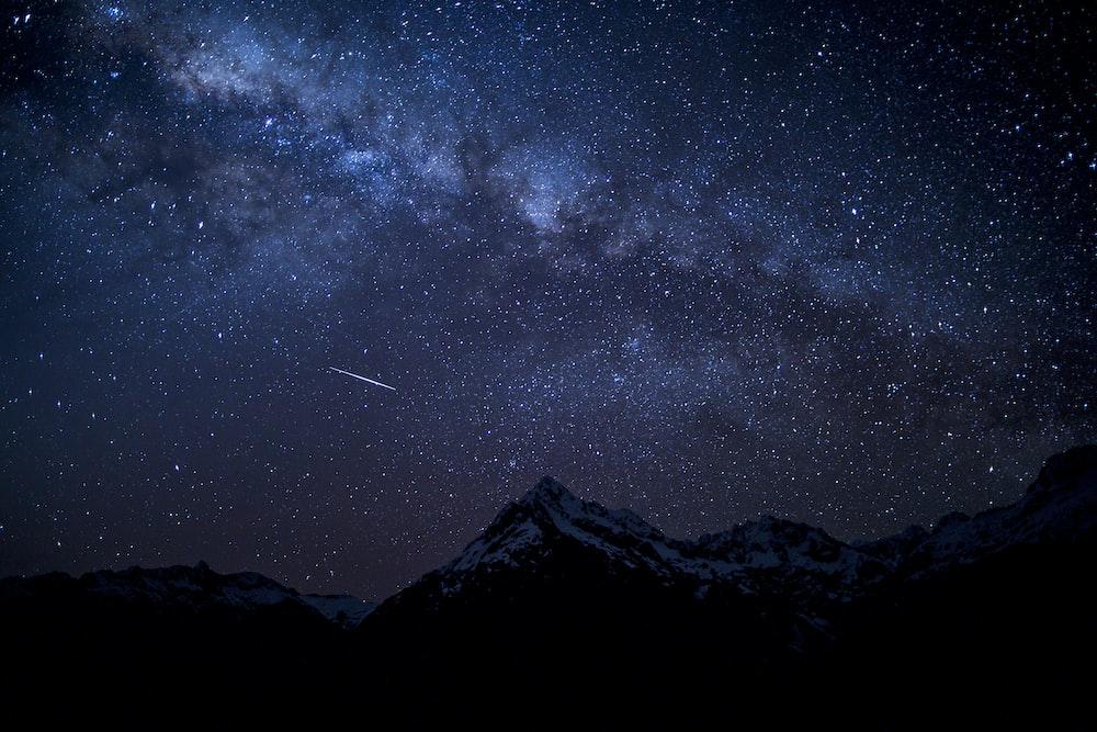 silhouette of mountain peak at nighttime