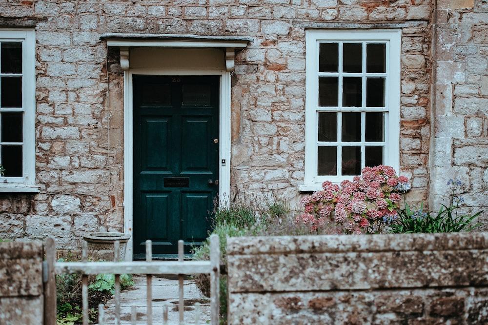 green wooden door during daytime