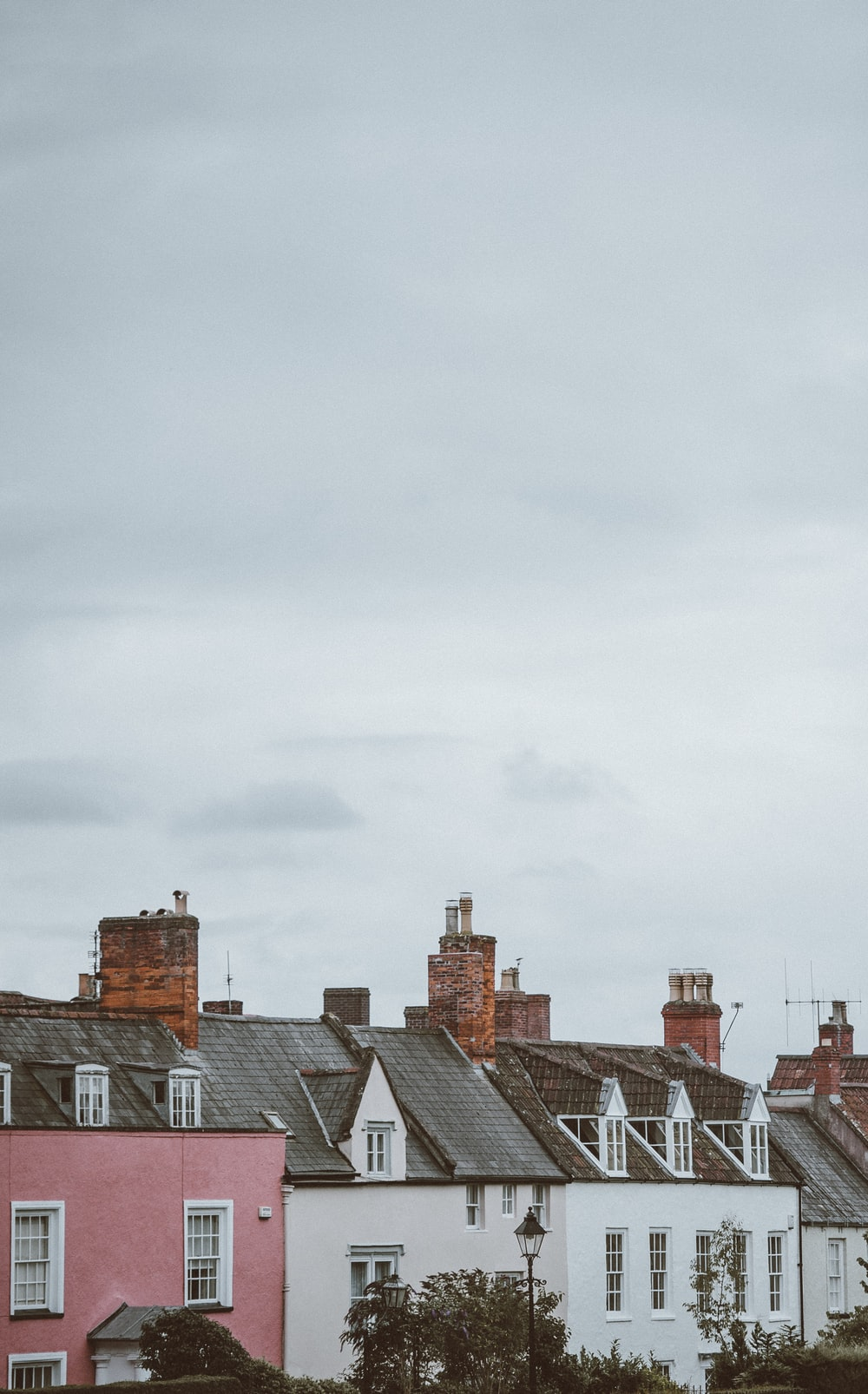 houses under cloudy sky