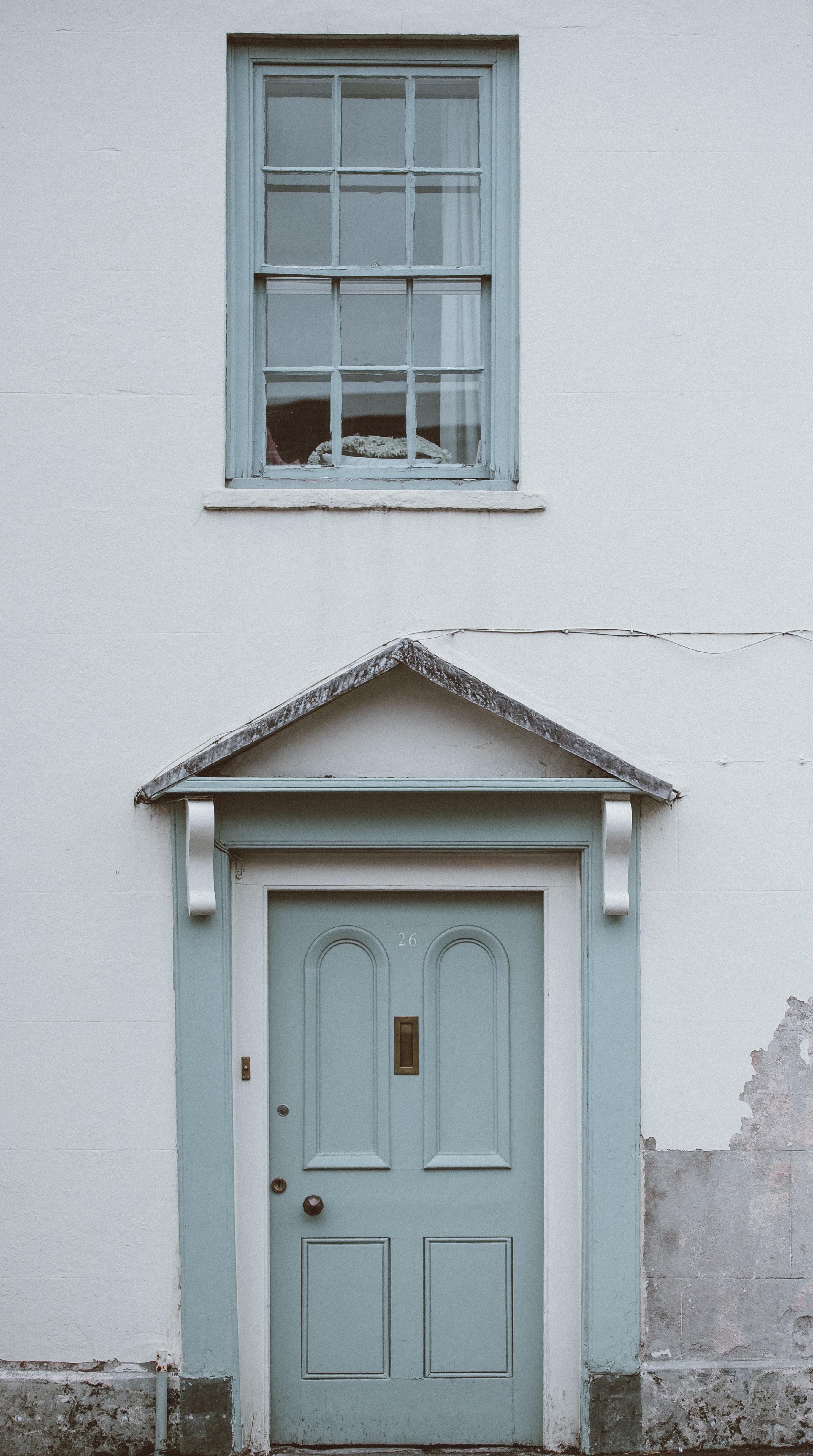 gray wooden 4-paneled door