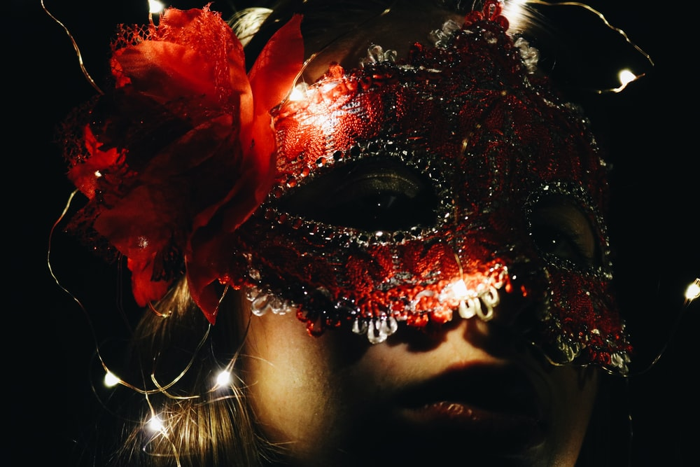 woman wearing red mask