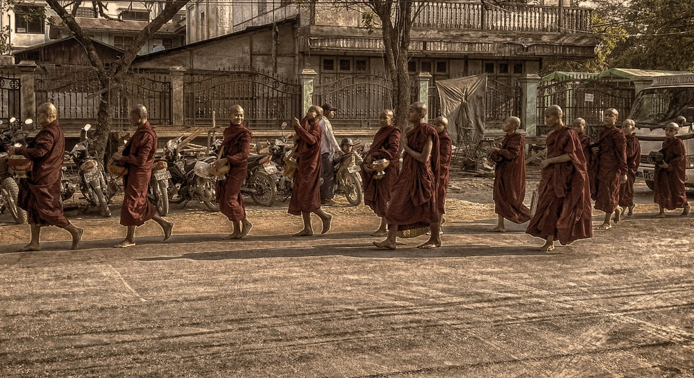monks marching on street