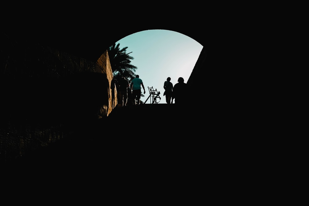 silhouette of man riding bicycle