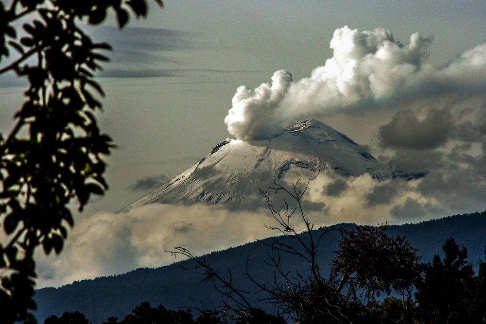 time lapse photography of mountain with smoke on its mouth
