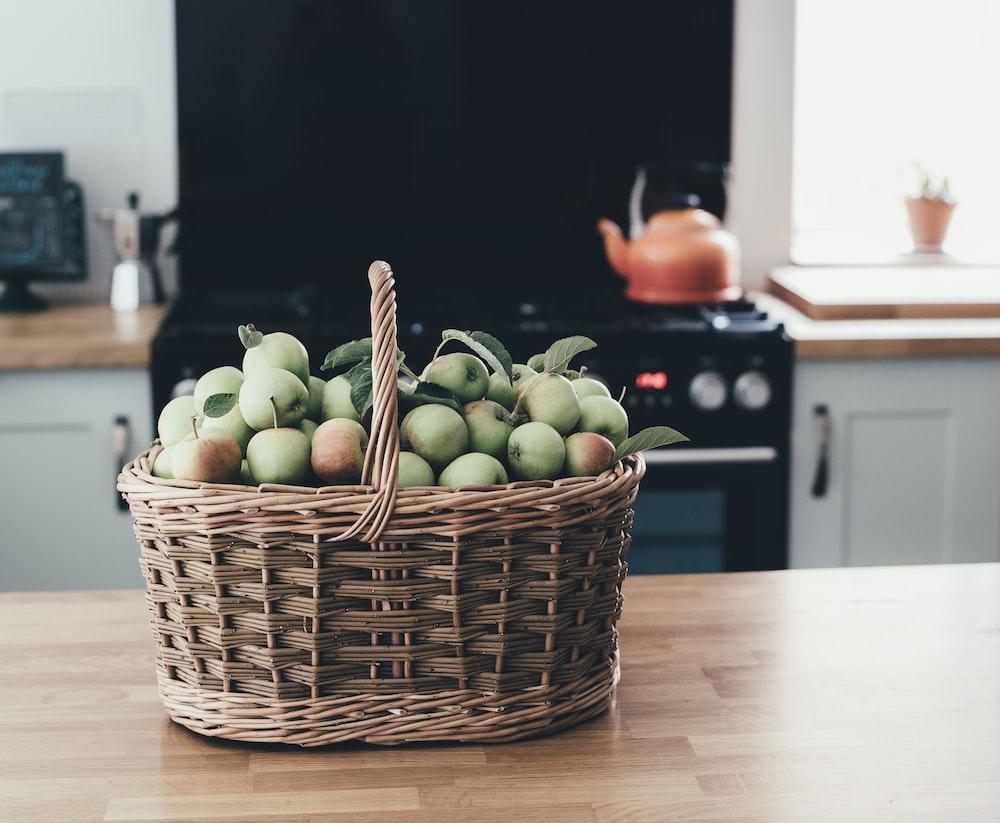 basket of apple in brown panel