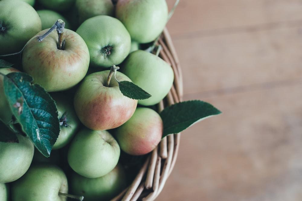green apple in basket