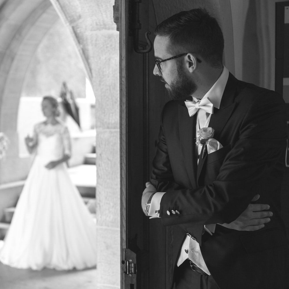 man looking at his bride